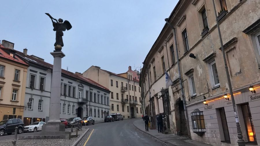 The Angel of Užupis at a square in Republic of Užupis Architecture Building Exterior City Sky Built Structure Outdoors Clear Sky Day