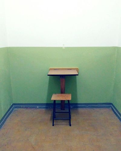 One desk to write Loneliness In A Picture Loneliness Place To Write Prison Chair Exterior Wall - Building Feature Politics And Government Stone Wall Government Closed Confined Space Citizenship