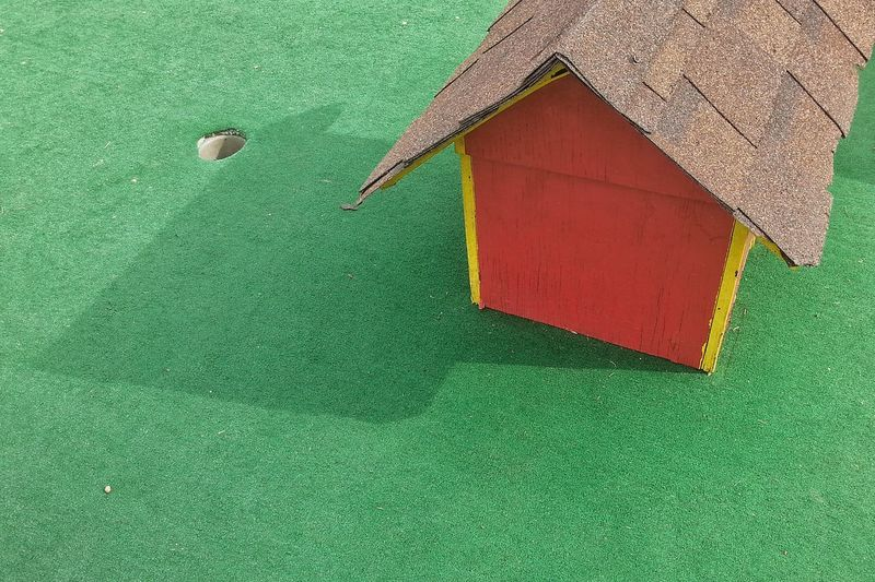 High Angle View Of Playhouse On Turf