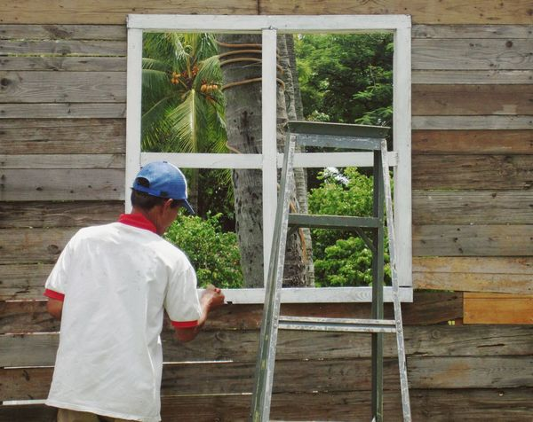 Tropical Paradise inside. One Person Outdoors One Man Only Real People Rear View Painting Worker Fresh On Eyeem  Man Working Renovation Project Repaint Windows Freedom Inside Paradise Inside Fresh On Eyeem