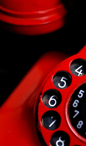 Close-up of red rotary phone