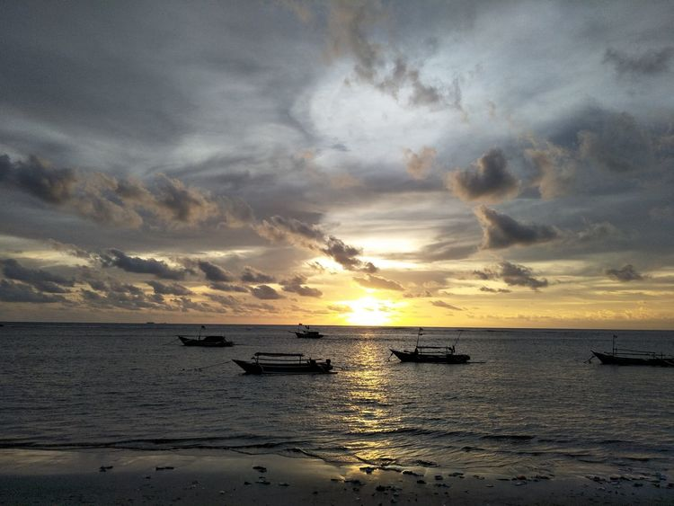 Sunset Sea Horizon Over Sea Over The Objects And Subjects Horizon Outdoors Cano Lake Yellow Color Bengkulu Indonesia Long Beach Island Boats⛵️ Adventure Beach Canoe Lake Nautical Vessel Beauty In Nature Silhouette Water Horizon Over Water Moored Outrigger Tranquil Scene Tranquility Mode Of Transport Nature Transportation No People Sky Scenics Cloud - Sky