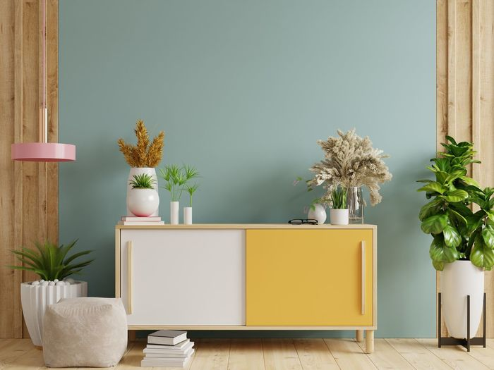 Potted plants on table against wall at home