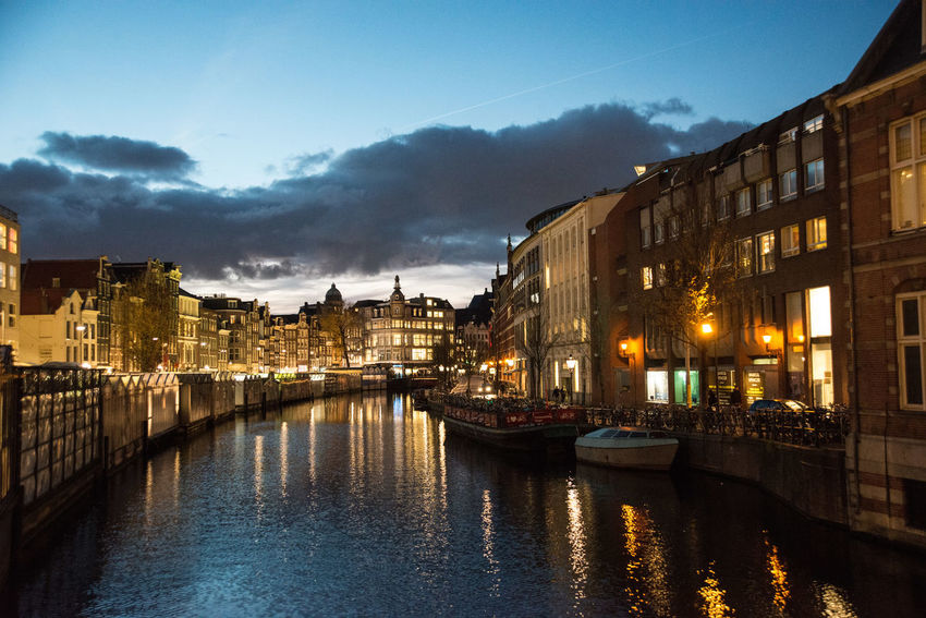 Amsterdam Reflection Architecture Building Exterior Built Structure Canal City Cityscape Cloud - Sky Evening Illuminated Nautical Vessel Night No People Outdoors River Sky Transportation Travel Destinations Twighlight Water Waterfront