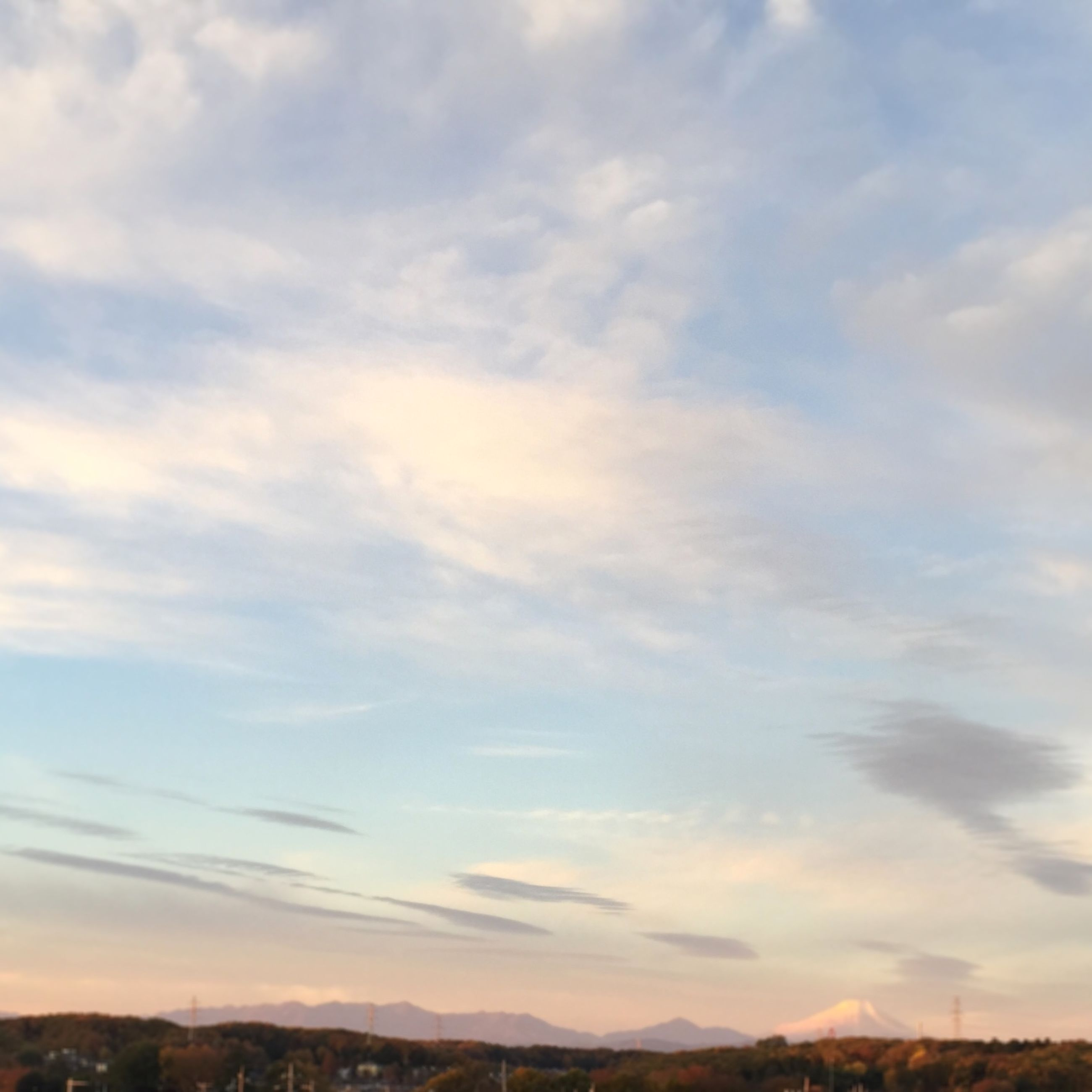 sky, landscape, tranquil scene, scenics, cloud - sky, tranquility, beauty in nature, mountain, nature, cloud, cloudy, sunset, idyllic, horizon over land, outdoors, mountain range, no people, non-urban scene, field, remote