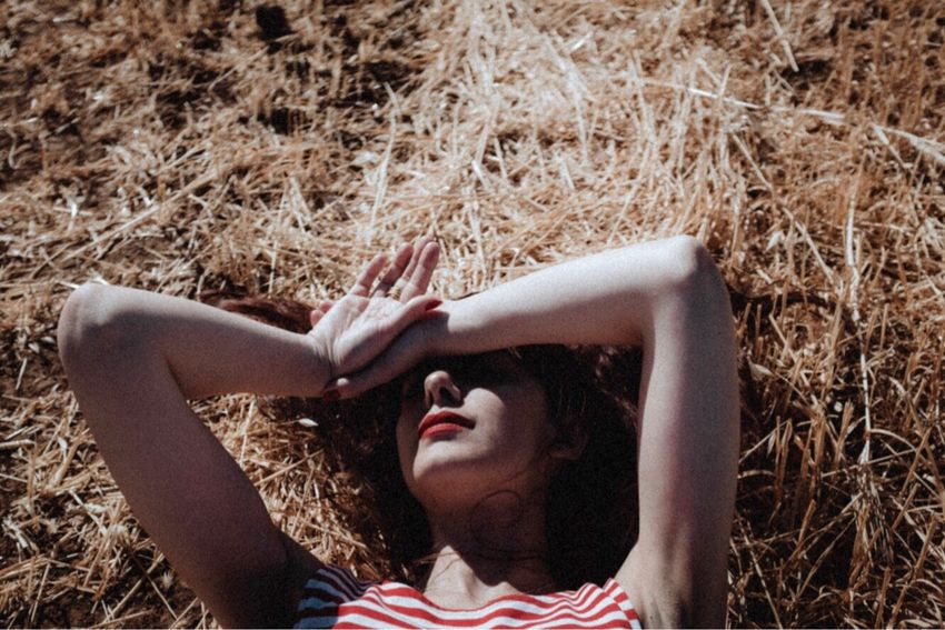 Young Women Red Lips One Person Beauty Beautiful Woman Portraits Portrait Of A Friend Portrait Of A Woman Girls Natural Light VSCO Cam Light And Shadow Shadows & Lights FujiX100T Atmosphere Shadows Composition Portrait Relaxation Grass Summer Outdoors