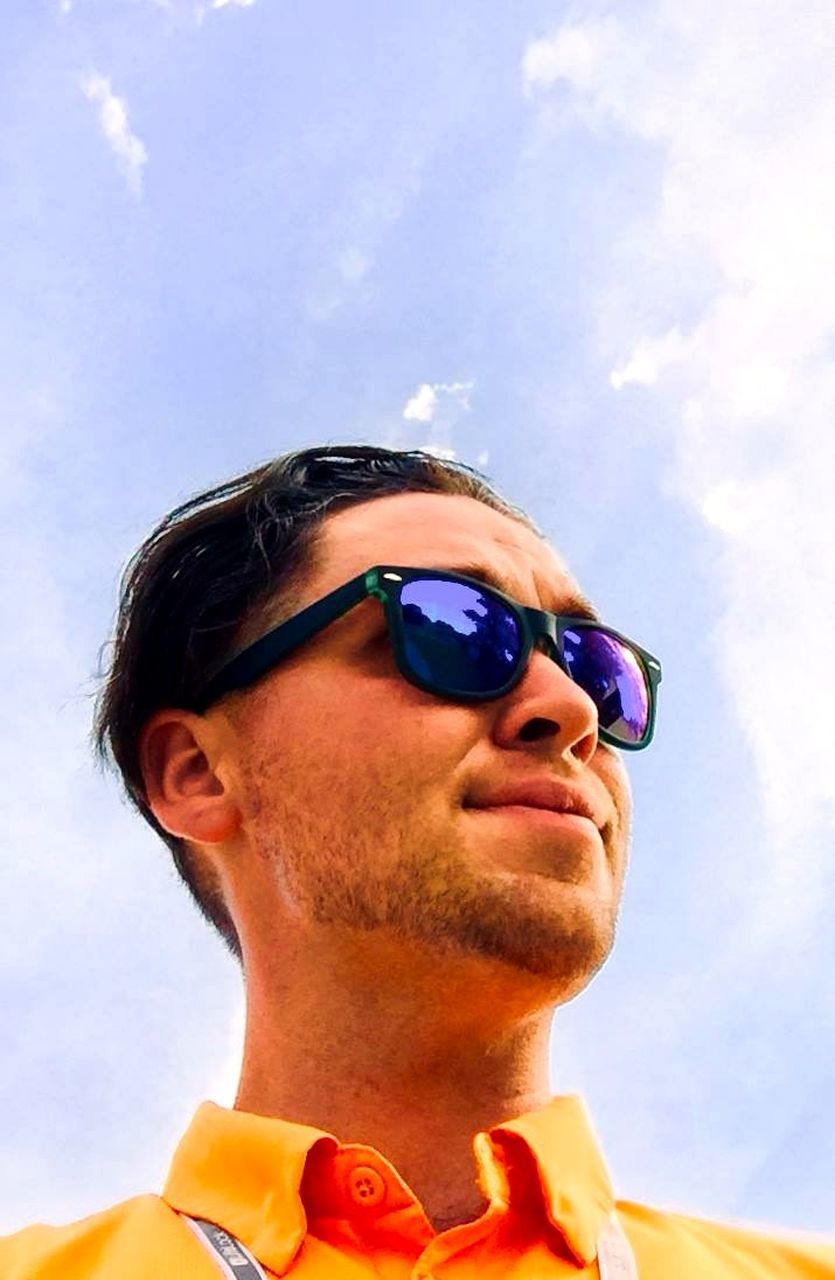 sky, glasses, one person, headshot, cloud - sky, sunglasses, portrait, fashion, low angle view, nature, day, adult, young adult, real people, outdoors, leisure activity, front view, close-up, human face