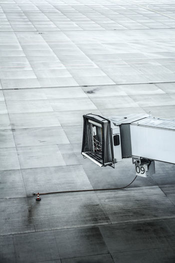 High angle view of passenger boarding bridge at airport