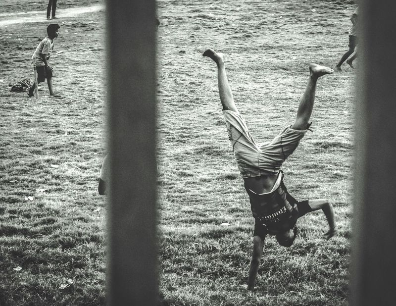 Life Upside Down. Sunlight Day Outdoors Light And Shadow Real People Welcome To Black Upside Down Gymnastics Teenager Chittagong Bangladesh EyeEm Diversity The Secret Spaces The Street Photographer - 2017 EyeEm Awards The Photojournalist - 2017 EyeEm Awards