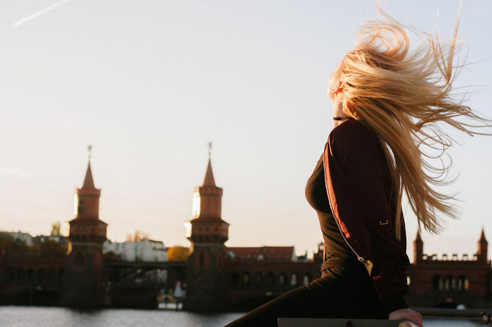 windy Adult Adults Only Architecture Berlin City Clock Tower Cultures Oberbaumbrücke One Person Only Women Outdoors People Sunset Tourist Travel Travel Destinations Urban Skyline Women Young Adult Capture Berlin Discover Berlin Press For Progress