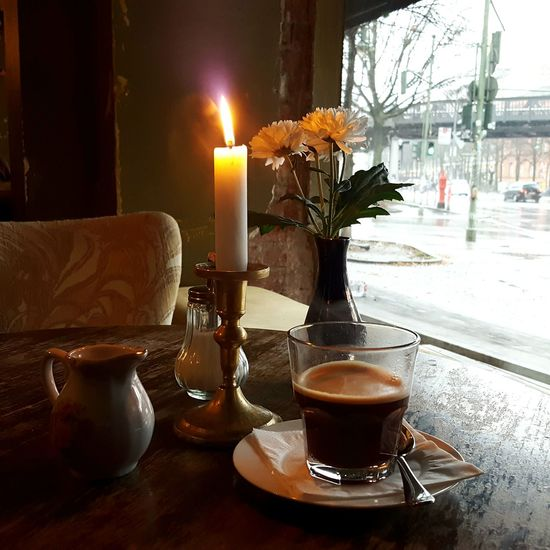 Rainy winter days in Berlin Finding New Frontiers Coffee Candlelight Flame Winter Table No People Coffee Time Capture The Moment Rainy Day Flowers Coffee Shop Kreuzberg Berlin
