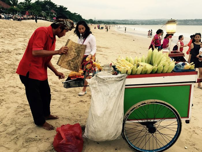 Bali, Indonesia Barbecue Beach Corn Cultures Men Outdoors Real People Sea Selling