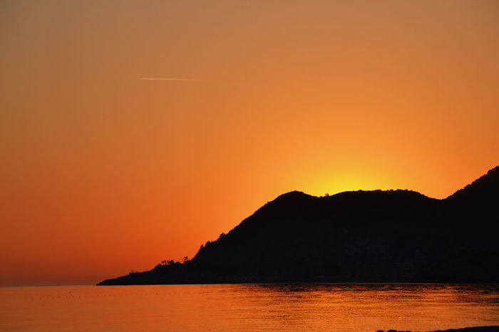 Alany Beauty In Nature Clear Sky Copy Space From The Balcony Idyllic Lovely Sunset Majestic Mediterranean Sea Mountain Mountain Range Nature No People Non-urban Scene Ocean Orange Color Romantic Sky Scenics Sea Silhouette Sunset Tranquil Scene Tranquility Water Waterfront