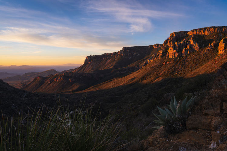 Scenic view of rocky mountains against sky during sunset in big bend national park - texas