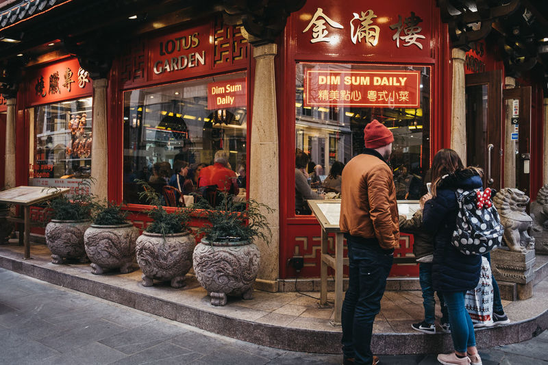 London Uk Europe Travel Tourism Real People Chinatown Soho Chinese Culture Area People Casual Clothing Retail Display Rear View Lifestyles Group Of People City Leisure Activity Adult Restaurant Dim Sum Chinese Food Standing Water Reading Menu Outside Outdoors Streetphotography City Life