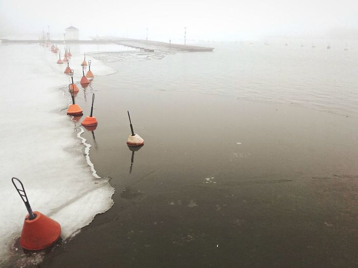Buoys on frozen lake