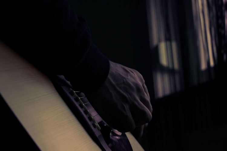 Guitar Guitarist Curtain Dark Close-up Focus On Shadow Hooded Shirt Thoughtful Thinking Low Section Long Shadow - Shadow Hooligan Hood - Clothing Velvet Paved Wearing Shoe Legs Crossed At Ankle Canvas Shoe Footwear