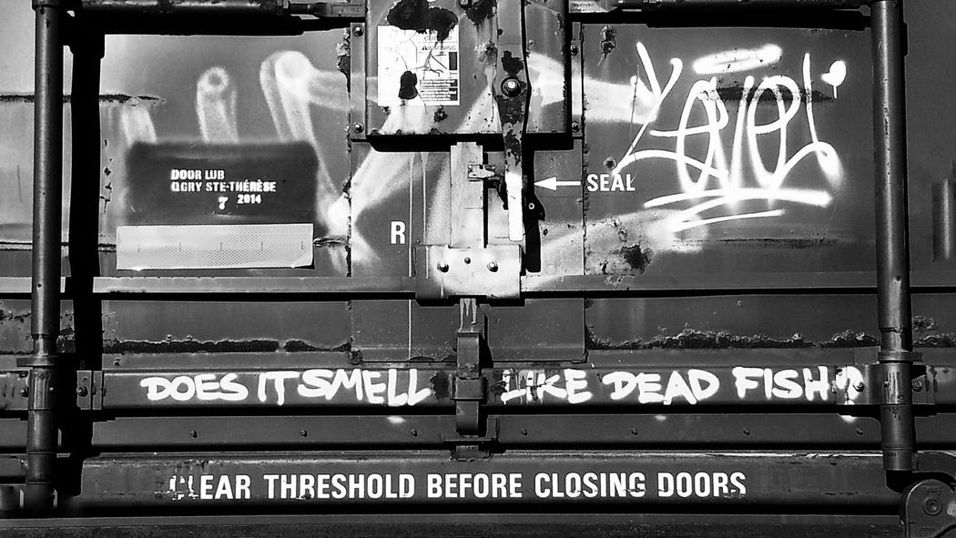 """""""Does it smell like dead fish?""""... Letters In The City for Bnw_friday_eyeemchallenge Boxcar Train Graffiti  Writing On The Walls Appreciate The Little Things In Life Comic Relief Attention To Detail For The Love Of Details Showcase: November Urban Exploration Up Close Street Photography Telling Stories Differently Your Design Story Monochrome Photography ミーノー!! Art Is Everywhere Black And White Friday"""