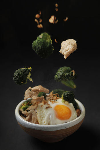 Close-up of salad in bowl against black background