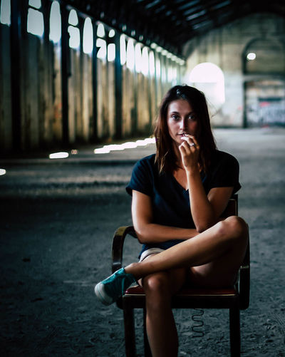 Portrait of young woman sitting outdoors