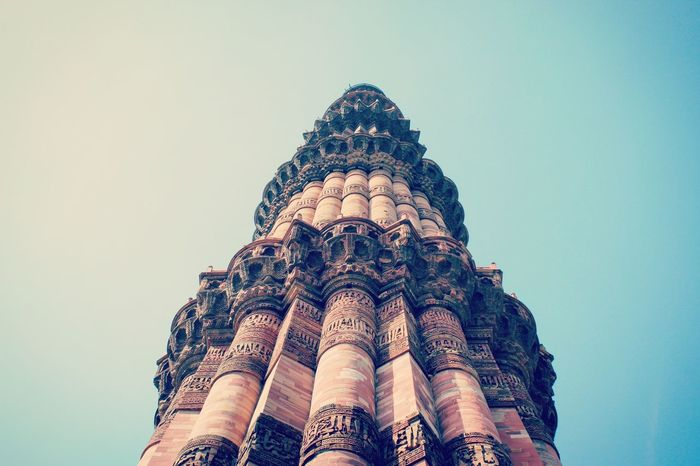 Qutub minar, New Delhi, India Low Angle View Design Detail Details And Colors Through My Lens Indiaclicks Indiaincredible Travel EyeEm Best Shots India Architecture_collection Eye4photography  Human Representation Vacations Tourism Travel Destinations Architecture Building Exterior Built Structure Architectural Column Indiapictures