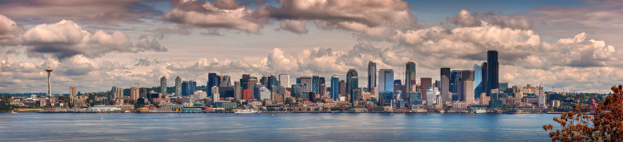 Panoramic View of the Seattle Skyline. The view of Seattle from across Elliott Bay from West Seattle. Architecture City Sky Cityscape Urban Skyline Cloud - Sky Office Building Exterior Building Water Skyscraper Landscape Panoramic Waterfront Travel Destinations Modern Bay Seattle Elliott Bay Skyline Salish Sea Washington Pacific Northwest  Puget Sound Panorama Summer
