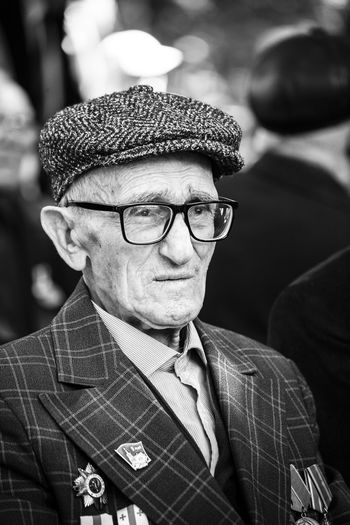 Veteran of World War II is attending the event dedicated to them. Each of the Veterans are more then 95 years old. The Portraitist - 2018 EyeEm Awards Adult Close-up Clothing Eyeglasses  Front View Glasses Hat Headshot Human Face Looking At Camera Males  Mature Men Men One Person Portrait Real People Senior Adult Senior Men Sunglasses