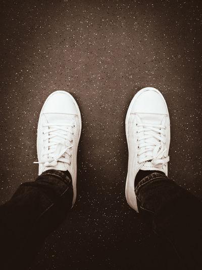 white shoe White Shoe Low Section Men Human Hand Standing Human Leg Shoe High Angle View Human Foot Close-up Human Limb Canvas Shoe Human Feet Symmetry Foot Unrecognizable Person Leg Pair