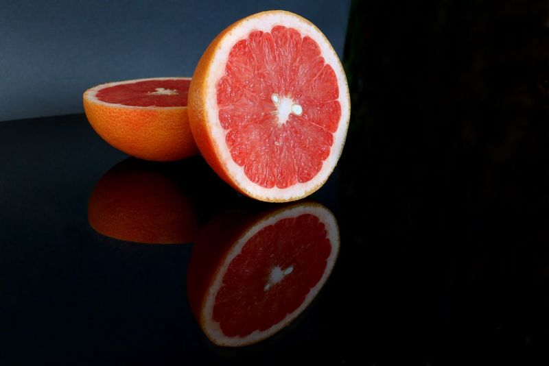 Appetite Black Background Citrus  Citrus Fruit Close-up Food Freshness Fruit Grapefruit Healthy Healthy Eating Healthyfood Immunity In Two Juice No People Orange Color Pomelo Pomelo Fruit Studio Shot