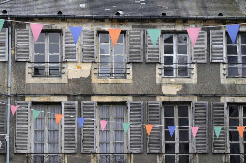 Flags in front of building facade, nevers, burgundy, france