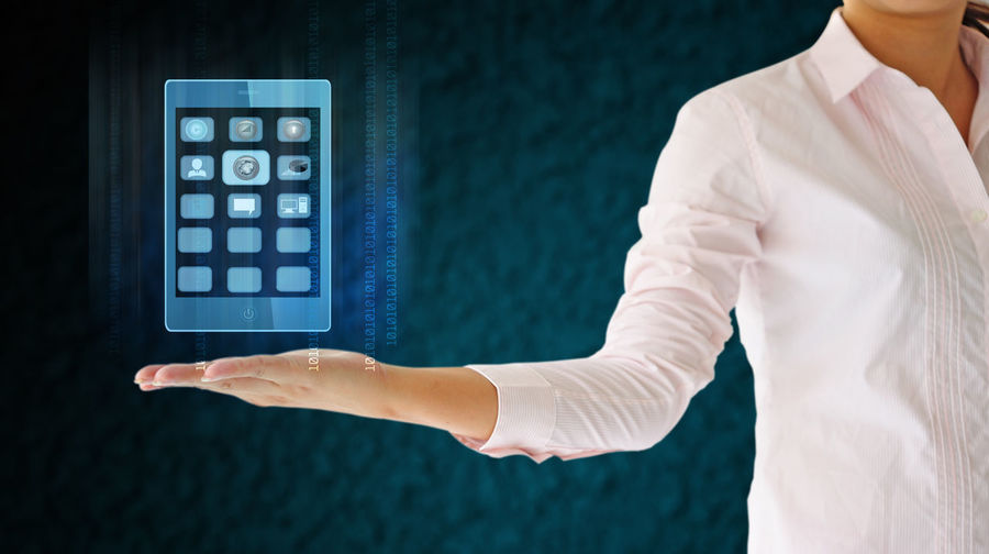 Digital composite image of businesswoman holding icon