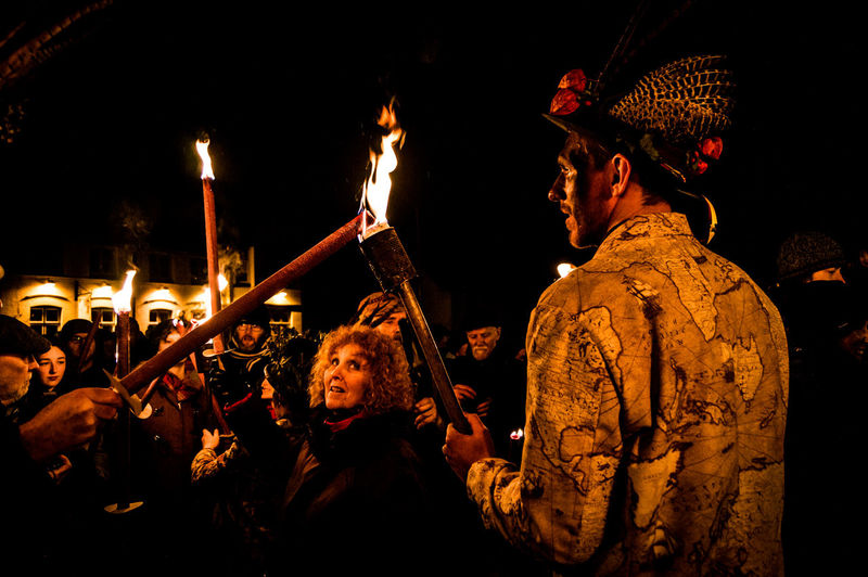 Eardisley, Herefordshire, UK. 6/7/2017. Members of the Leominster Morris folk dance group take part in a Mummers Play and torch lit Wassailing ceremony on the Epiphany, also widely known as Three Kings Day, or even Dia de los Tres Reyes Magos. The Christian holiday is typically celebrated 12 days after the Christmas in the Gregorian calendar, and serves, traditionally, to commemorate the baptism of Jesus. The holiday was also associated with the three kings' visit to the Christ child. Epiphany is used to describe the final day of the 12-day Christmas celebrations, as well as the season of Epiphany. Epiphany is celebrated globally within the Roman Catholic, Protestant and Eastern Orthodox faiths. Countries, from Mexico and Switzerland to Germany and Spain, observe the religious holiday. Adult Celebration Eardisley Epiphany Leominster Morris Night Outdoors People Torchlight Tradition Twelfth Night