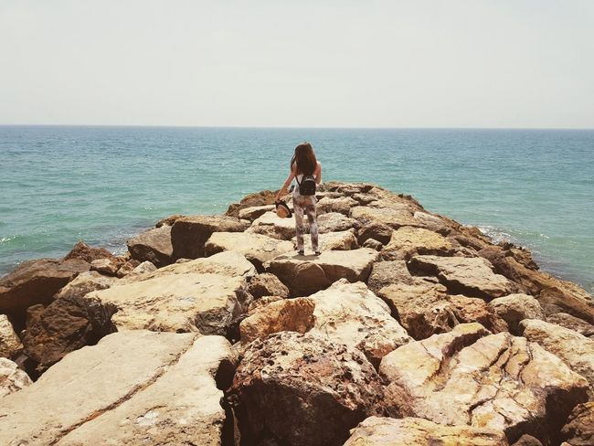 Sea Horizon Over Water Beach Rock - Object One Person Sunlight Full Length Rear View People Nature Leisure Activity Water Beauty In Nature One Woman Only Adults Only Outdoors Only Women Real People Relaxation Adult Nature Sky Day Vacations Scenery Shots