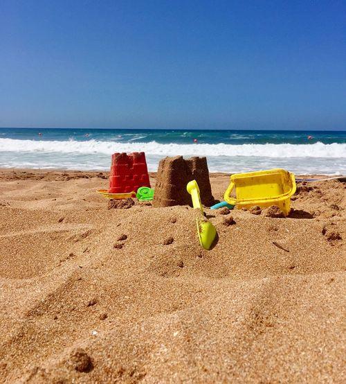 The Sandcastle ... Sand Beach Sandcastles Sea Bluesky Bluesea Childhood Children Sandtoys Toys Colors Summer Summer Views Summertime Relaxing Moments Relax Taking Photos Nature
