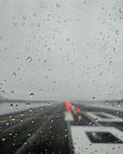 Runway, rain.