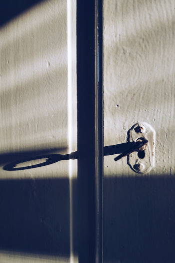 Close-up of key in hole of door