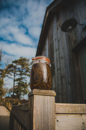 Wood - Material Focus On Foreground No People Metal Day Built Structure Architecture Low Angle View Old Close-up Sky Nature Cloud - Sky Outdoors Post Pattern Container Rusty Lighting Equipment Wooden Post