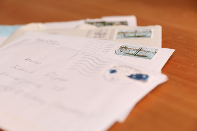 Close-up of envelops on wooden table