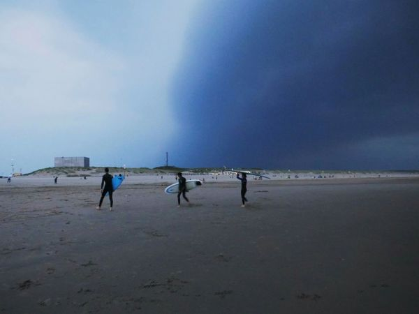 Surfers Changing Weather Sky Clouds And Sky Before Storm Taking Photos Beach Light And Shadow