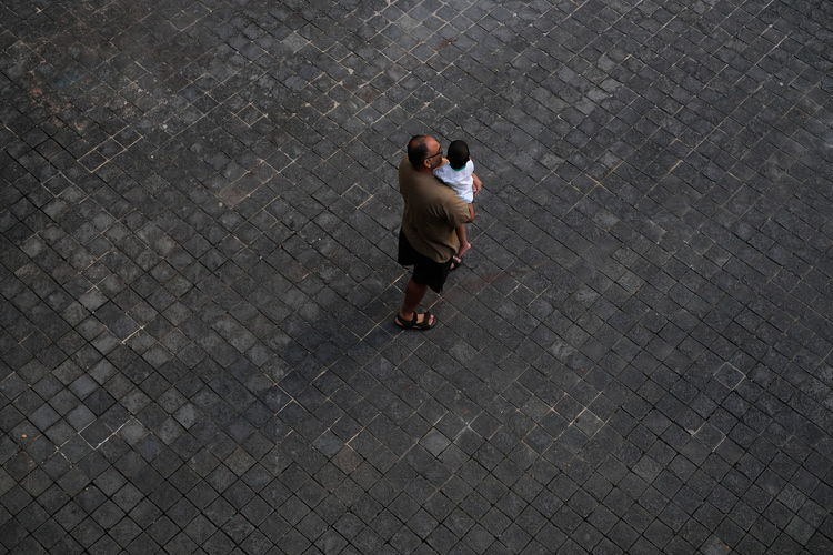 High angle view of woman walking on footpath