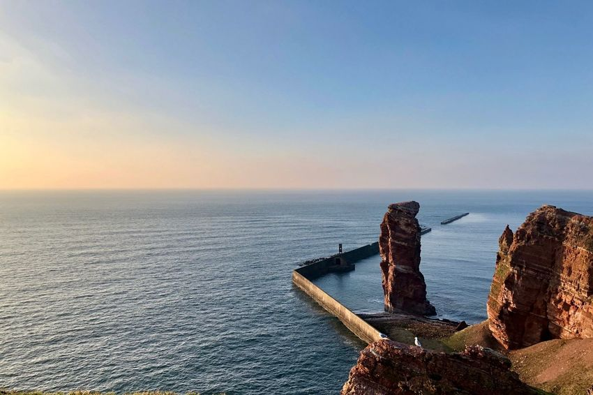 The rock 'Lange Anna'. Landmark of the VERY small german island Helgoland. Helgoland Helgoland_Lange Anna Landscape_Collection Travel Photography Beauty In Nature Germany Helgoland_collection Island Landmark Nature_collection North Sea Red Sandstone Rocks Sea Sunset Travel Destinations