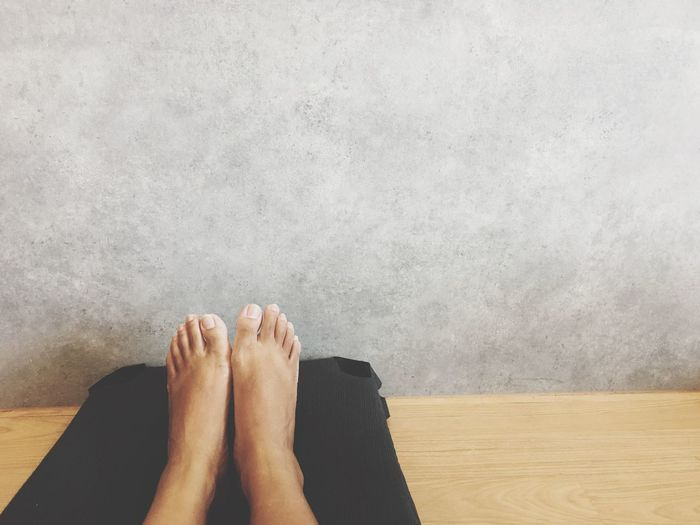 Low Section Of Woman Relaxing On Floor