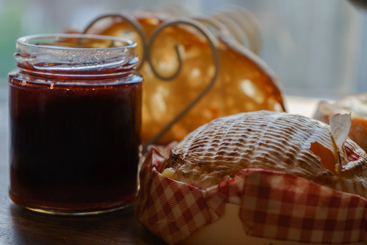 Close-up of camembert with jam bottle
