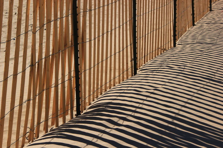 Burlap And Wood On The Beach Stripes On The Sand Day Monochromatic No People Outdoors Pattern Sand Color Striped