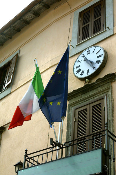 Facade of the city palace Architecture Building Exterior Built Structure Clock Day Flag Hanging Italy Lazio Low Angle View No People Outdoors Patriotism Time Via Amerina Window