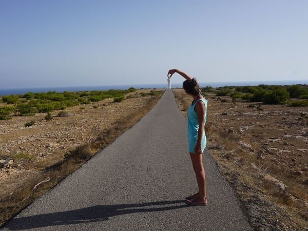 One Person Young Adult Standing Formentera Island EyeEmNewHere Baleares Lighthouse Way Roadtrip Summer Balearic Islands TRYP Faro World In Hand Nature Alone Clear Sky Young Women Lifestyles Outdoors Beauty In Nature Human Hand Summertime Mediterranean  Formentera Mix Yourself A Good Time