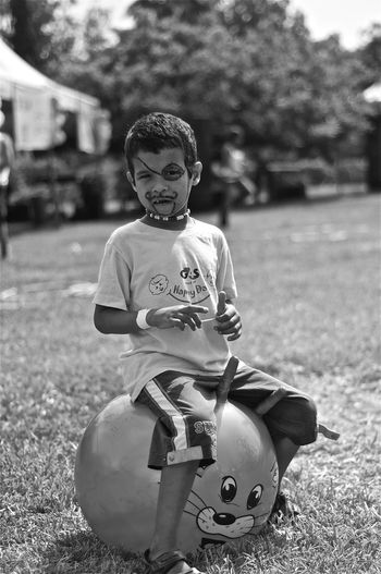 Blackandwhite Bouncing Boy Child Focus On Foreground Kid Outdoors Playing Portrait