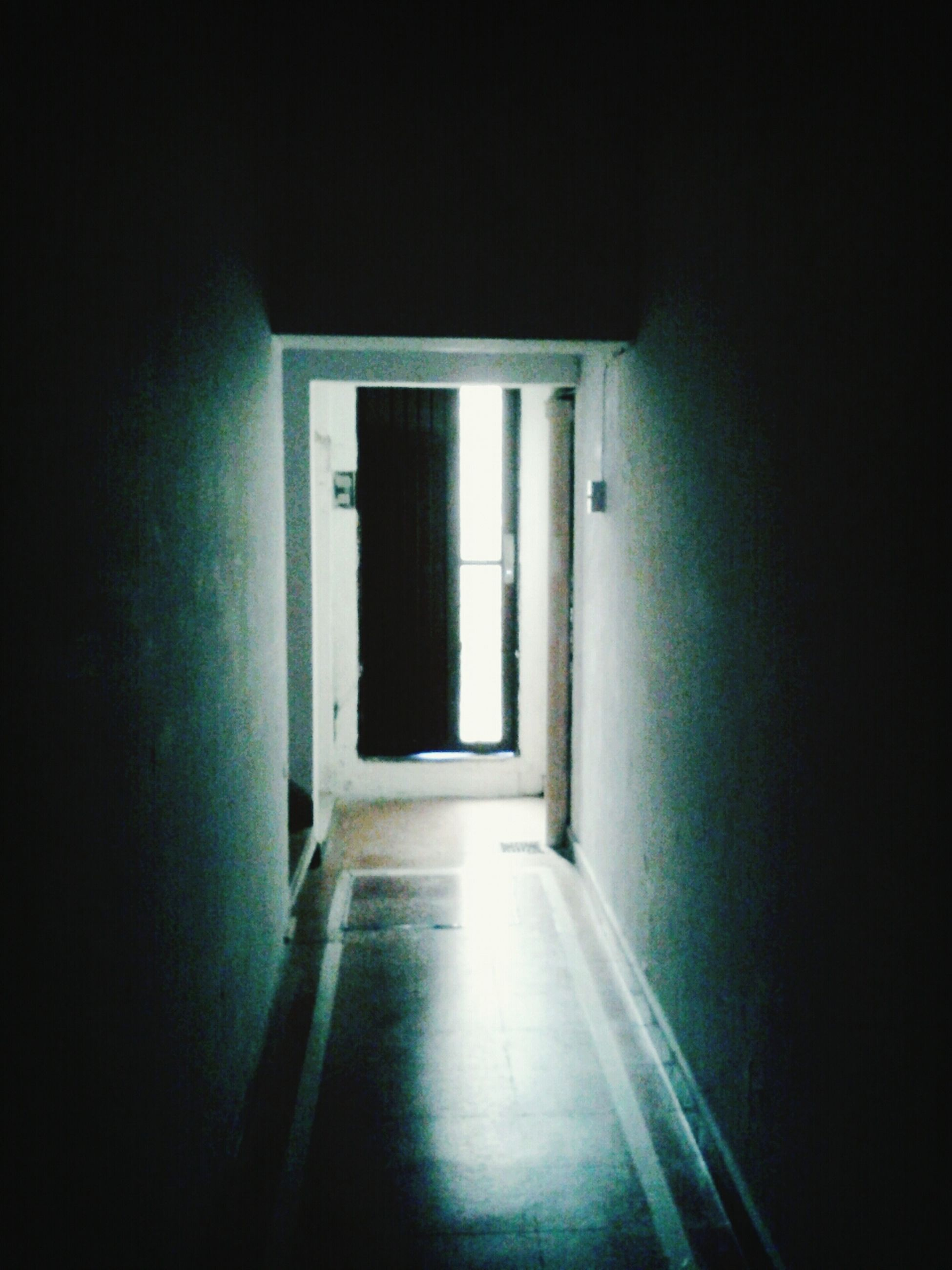 indoors, architecture, door, built structure, empty, the way forward, wall - building feature, wall, window, corridor, illuminated, absence, entrance, doorway, no people, dark, closed, narrow, house, building