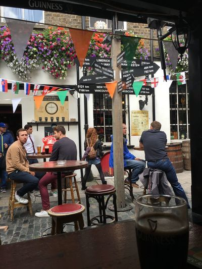 Dublin Ireland Pub Home Colours Guinness People Photography Sitting Chair Table Multi Colored Travel Destinations Postcard