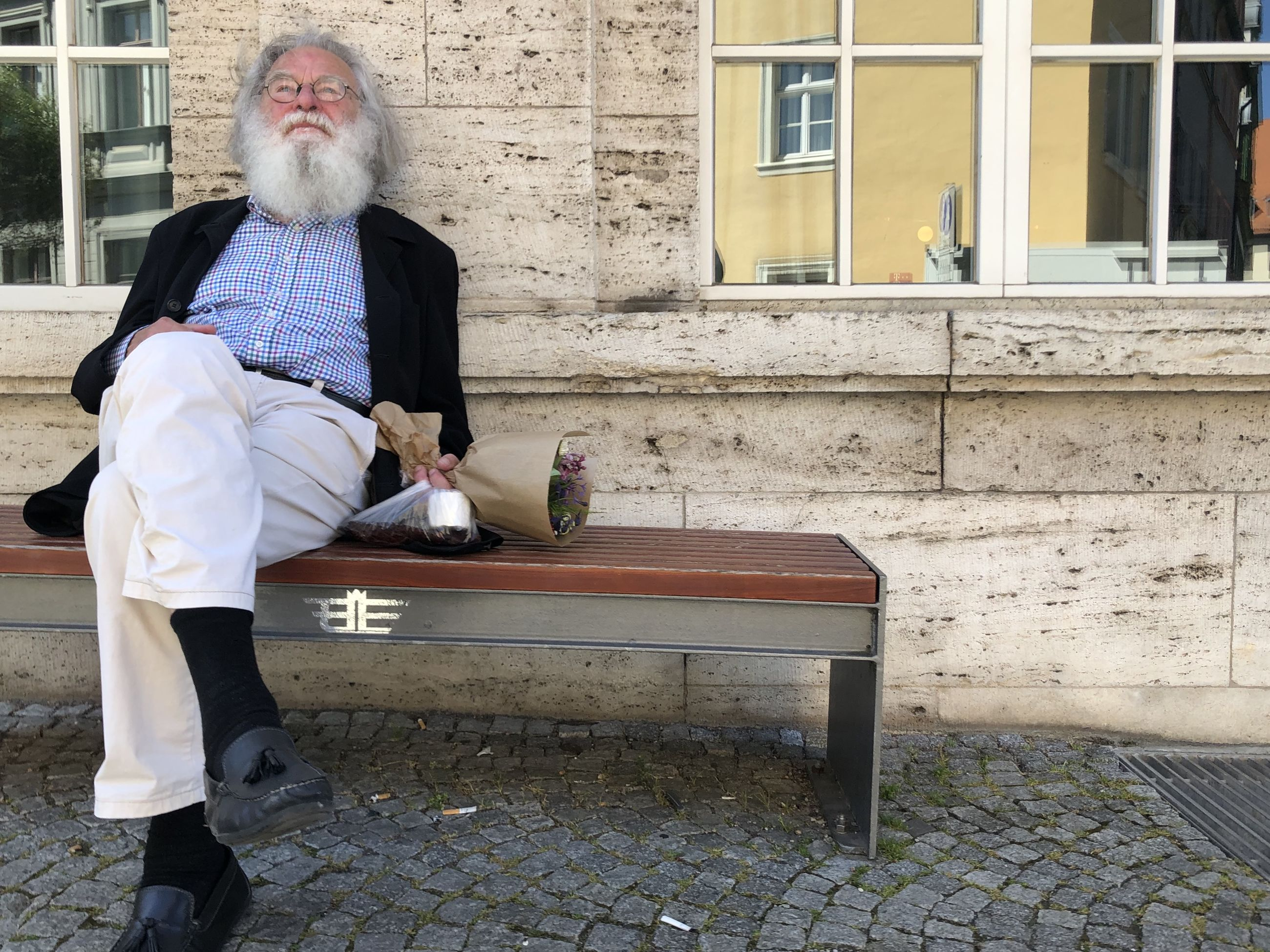 senior adult, adult, one person, men, architecture, seniors, full length, bench, seat, sitting, building exterior, lifestyles, facial hair, built structure, city, women, gray hair, person, clothing, beard, retirement, leisure activity, day, casual clothing, furniture, portrait, street, front view, outdoors, footpath, emotion, relaxation